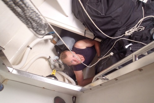Trying to deal with plumbing issues in the sail locker.